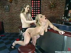 Crystal Frost and Princess Kali make hot lesbian show at a bar. One of them gets whipped and then fucked from behind with the strap-on.