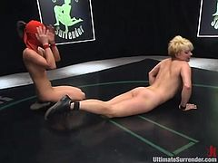 A couple of fuckin' slutty bitches wrestle naked and start fondling and groping each other while on the ground. Check it out right here!