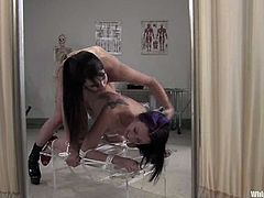 Brunette bombshell Bobbi Starr is having fun with sweet girl January Seraph in a hospital ward. Bobbi dominates Seraph and then smashes her pussy with a strapon.