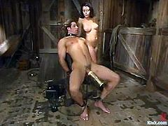 Nick Jacobs allows brunette mistress Penny Flame to tie him up in a basement. Then the slut whips Nick's ass with a lash and drills it deep and hard with a strapon.