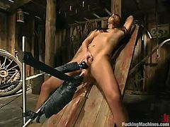 Asian skank Bobbi Blair is having fun in a barn. She fondles herself passionately and then gets her tight cunt destroyed by a fucking machine.