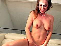 Nora Noir is a good looking horny slim milf with long legs and nice boobies. She shows off her lovely body as she gets her nicely trimmed pussy drilled by horny boy.