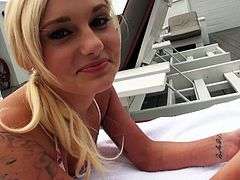 Blonde bombshell Charli Shiin is seductive blonde girl with slim sexy body shape. She is lying flat on her stomach sun bathing on a deck chair. Sexy blonde girl later plays with her pussy teasing the guy.