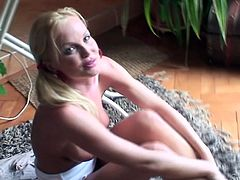 Naughty blonde MILF with pigtails lifts her skirt up and lies down on the floor. Then she starts to play with her pussy and nipples.