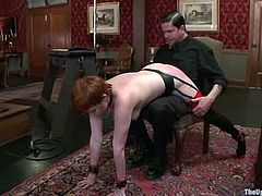 Chubby redhead milf Lilla Katt is having fun with some guy indoors. She lets him bind her and loves being tortured and spanked.