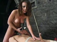 Sexy Penny Flame ties Danny Wylde up. Then she tortures his nipples and dick. After that she pounds him in the ass with a strap-on.