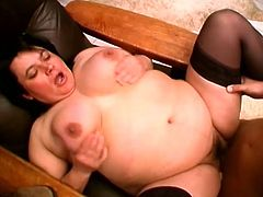 Horny fucker is ready for some blowjob and that nasty fat ass slut is perfect in that, she takes his cock and puts it between her tits.