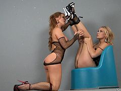 Silvia Saint and Michelle pose for a camera in sexy lingerie and high heels. Then they lick boobs and play with each others pussies.