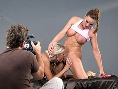Silvia Saint and Jessie Hazel pose in sexy lingerie. Then Jessie licks Silvia's hot pussy. After that she gets her tight pussy toyed from behind.