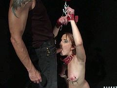 Filthy redhead chick with saggy natural tits is a big fan of rough sex with restraint elements. So she gets her hands tied up and her tits pinned with clothes pan. Her master fucks her cunt hard from behind.