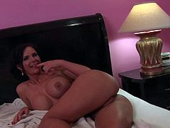 Diana Prince is a lovely dark haired MILF that shows every inch of her perfect body in the bedroom. She exposes her bare round ass and her big boobs with smile on her face. Shes so sexy!