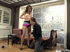 This lovely girl in high heels knows what she wants. She grabs her lover by his head and pulls him towards her fake phallus. Horny dude sucks it greedily as if his life depends on it.