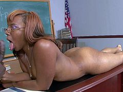 Elena Love is a hot black chick with glasses that strips down to her bare skin and takes big hard dick on a desk in the classroom. Watch big ass ebony girl give blowjob and get her shaved pussy boned.