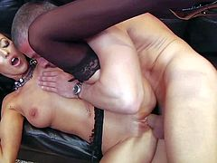 Black haired stunning Breanne Benson with nice natural tits and smoking hot fit body in stockings only seduces tall stud Mick Blue and gets rammed to orgasm on leather couch.
