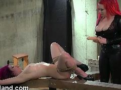 Watch this sexy femdom Gothic mistress and her sexy shave pussy slave tied down.She whips her hard and toys her tight pussy with huge dildo while she moans with pain and pleasure.