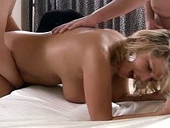 A horny blonde cougar is playing dirty games with two studs in a bedroom. She lets them lick her snatch and then gets double penetrated and moans loudly with pleasure.