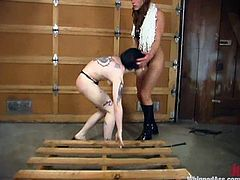 Nerdy brunette girl gets whipped by unmerciful Kym Wilde. Later on Kathleen also gets her body covered with wax.