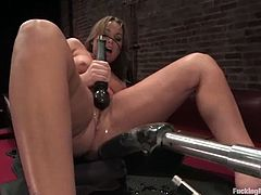Brown-haired milf Flower Tucci is having some fun in a dark basement. She rubs her meaty vag with a dildo and then gets it smashed by a fucking machine.