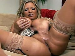 Stunning blonde chick with huge natural boobs poses for the camera and shakes her tits in close-up scenes. Then she gives a titjob and gets her wet pussy fucked.