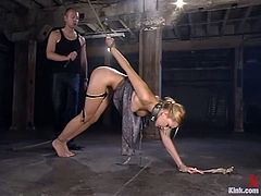 Amazing blonde girl gets tied up and whipped in a basement. Later on she sucks big hard cock and licks balls.