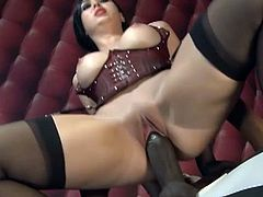 Watch the corsetted brunette Angell Summers sucking two big cocks, a white and a black one before riding them with her clam and hot ass.