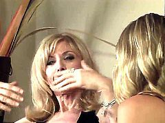 Two blondes, milf and a teen babe, Nicole Ray and Nina Hartley spend some quality time with each other in the living room and engage in a hot pussy licking session