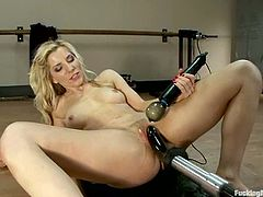 While a fucking machine is pounding her sweet cunt, Ashley Fires uses a vibrator to improve the hot sensations.