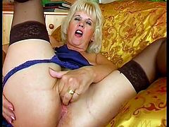 Home alone means only one thing for this sexy blonde mature in black stockings, nasty masturbation that includes pussy fingering and rubbing.