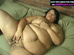Nasty BBW whore smears cream over her boobs getting messy on a couch. After eating dessert the girl plays with her pussy craving for orgasm.