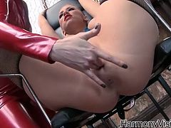 Red latex mistress finger fucks and blonde hoochie wearing sexy black stockings. She stimulates her clit with vibrator and makes her moan of great delight.