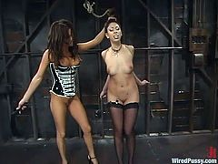Two horny chicks come to make some BDSM love! They get naked and Satine Phoneix starts torturing Tory Lane! She suspends her in hogtie and stick some wires in her pussy!
