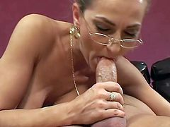 Long-haired mom Darien Ross wearing glasses is having fun with some young stud. She favours him with a blowjob and then they fuck in cowgirl and other positions.