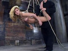 Imagine getting hogtied and suspended! That's gonna fucking tear you apart, but not Jenni Lee for sure. Lew Rubens has no mercy!