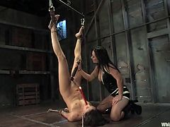 Horny brunette girl gets tied up and tortured with hot wax by Sandra Romain. After that she also gets suspended and drilled with big dildo.