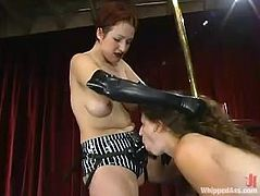 Brown-haired chick gets choked and spanked by her mistress. Later on she also sucks the strap-on and gets toyed in different poses.