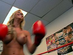 Buxom blonde hun Jessica Lynn was practicing her boxing skills on punching bag. Later Jessica got topless and let one cocky trainer suck her udders.