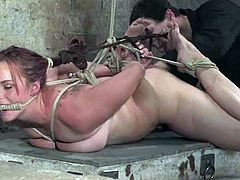 Busty brown-haired girl Bella Rossi is having fun with some guy in a cellar. The dude puts Bella into a cage and stuffs her amazing holes with toys.
