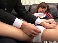 Pretty Japanese girl Rina Rukawa is having fun with her groupmate in college. She allows the dude to rub her vag with a dildo and seems to enjoy it much.