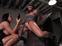 Horny Asian girl gets tied up and blindfolded by her busty mistress. Then Keeani gets her tits stimulated with electricity and ass toyed with a strap-on.