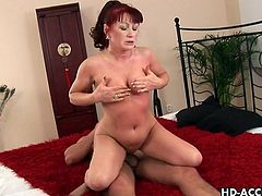 This sexy MILF looks great in her black panties. But they are soon taken off by a hung black stud who fucks her deep and hard on the kitchen counter.