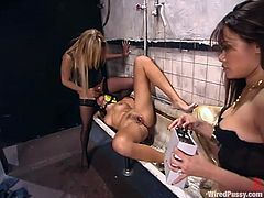 Kat, Annie Cruz and Keeani Lei are playing BDSM games in a public bathroom. Keeani lets the two mistresses bind her and then gets her mouth and vag pounded with a strapon.