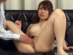 Nasty Japanese girl moves her legs wide apart and allows some guy to play with her pussy. Then they fuck in cowgirl position and doggy style and seem to be unable to stop.