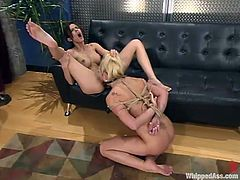 Horny Staci licks Shy's wet pussy and then gets tied up with ropes. Later on she gets her ass whipped and pussy toyed with a strap-on.