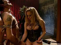Aiden Starr and Maitresse Madeline are having some fun with two submissive guys. The blondes tie the guys up and then play with their cocks and assholes.
