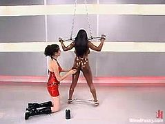 The busty ebony Jada Fire will be dominated in this bondage session by another chick who will use different devices to play with her, including a fucking machine.