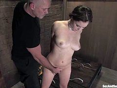 This amazing sex slave named Charlotte Vale is under the fantasies of BDSM king Mark Davis. He bondages her legs and her snatch is welcoming his penis!