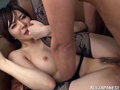 Insatiable Japanese milf Yuria Satomi wearing pantyhose is having fun with two dudes indoors. She admires the men with her cock-sucking talent and then enjoys sex in missionary and other positions.