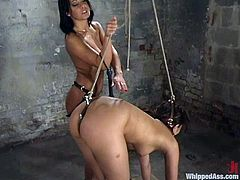 Annie Cruz and Sandra Romain are having some good time in a basement. Sandra suspends Annie and stuffs her ass with a hook and then tortures her and drills her cunt with a strapon from behind.