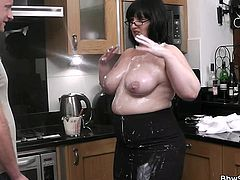 This fat whore is in the kitchen and she pours cake batter all over her gigantic boobs before she gobbles on a cock. Her man licks the batter off of this fat slut's big breasts. What a kinky fat bitch she is.