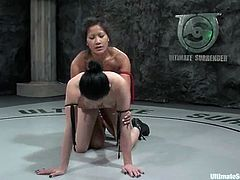 Two nasty chicks in bikini fight and then fuck. Alexa gets her sweaty pussy toyed with a strap-on because she loses a fight.